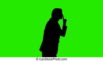 Video of woman's silhouette with quiet gesture - Video of ...
