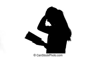 Video of young girl with book