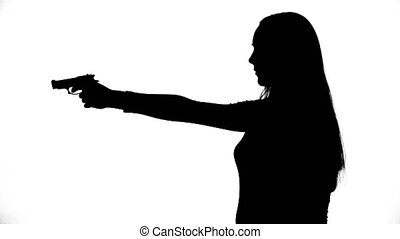 Video of young girl with gun - Footage of woman's isolated...
