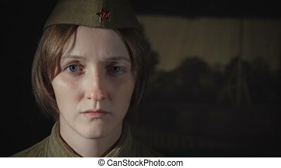 Video of young woman in sorrow wearing soviet red army uniform