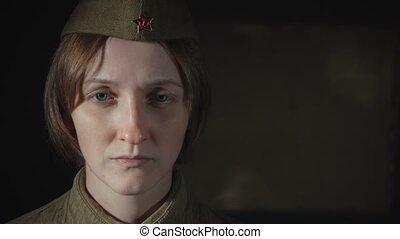 Video of woman in sorrow wearing soviet red army uniform