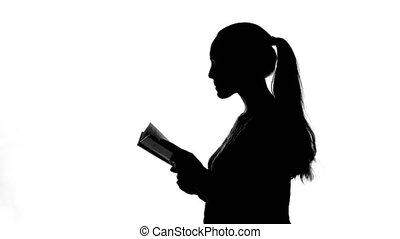 Video of young woman with book
