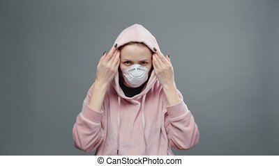 Video of young woman with medical mask in hood