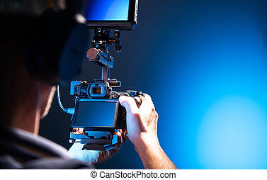 Video Operator with Modern DLSR Camera in Hands