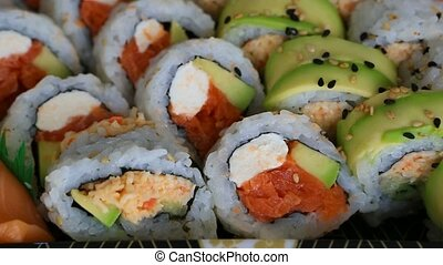 Video panning of a platter of delicious and fresh sushi rolls prepared with both raw and cooked ingredients 1080 HD
