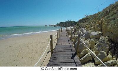 Video passage, on a wooden bridge on beach Olhos de Agua. -...
