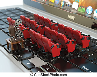 Video player application  or home cinema concept. Laptop and rows of cinema seats