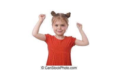 Video portrait of a beautiful happy little girl hands up in...