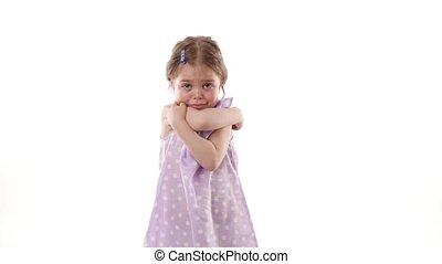 Video portrait of a frustrated child girl isolated on white background.