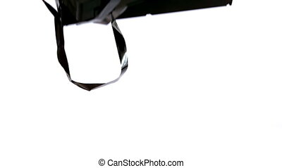 Video tape falling and bouncing on white background in slow...