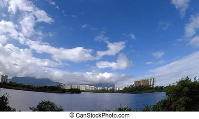 Video time lapse at Marapendi lagoon with clouds and blue sky. Rio de janeiro Brazil