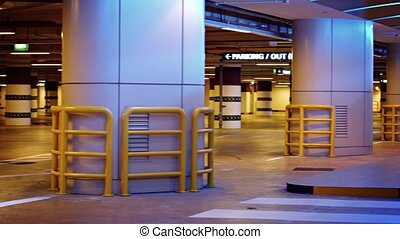 Video UltraHD - Columns and numeric section identifiers of an underground parking garage, with heavy duty, structural barriers