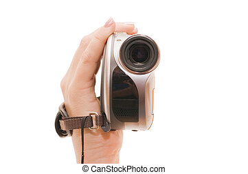 Videocamera in a female hand isolated on white