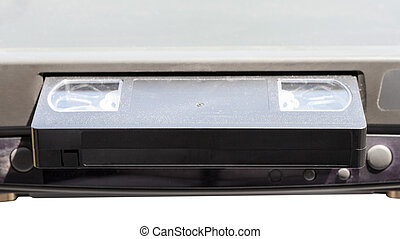 videocassette in video recorder isolated on white background