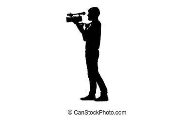 Videographer conducting shooting in the studio. Silhouette. White background
