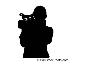 Videographer holds the camera. White. Silhouette