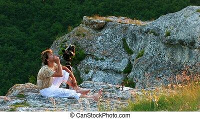 videographer on sunset mountain - videographer on sunset...