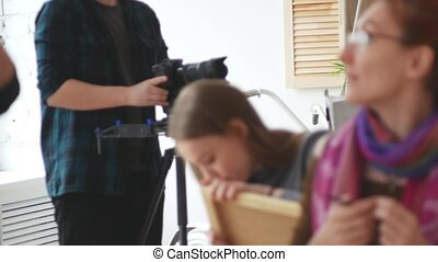 Videographer shoots at the camera artists in the studio,...