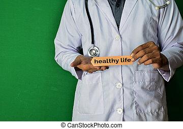 vie, docteur, sain, texte, monde médical, debout, arrière-plan., papier, vert, healthcare, prise, concept.