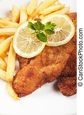 Viener schnitzel, breaded steak with french fries