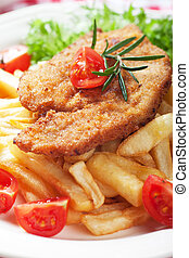 Viener schnitzel, breaded steak with french fries