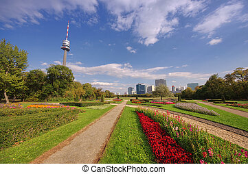 Vienna city and Danube Park with flowers