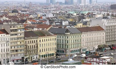 VIENNA - FEB 20: (Timelapse View) Viennese Danube tower stands against city landscape above roofs of houses, on Feb 20, 2012 in Vienna, Austria