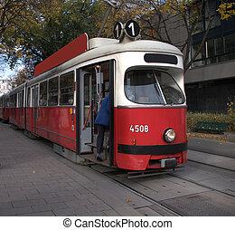 Vienna Streecar - A passenger boards a streecar in Vienna ...