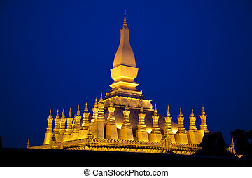 Laos. Vientiane. Nighttime photo of the pagoda lit