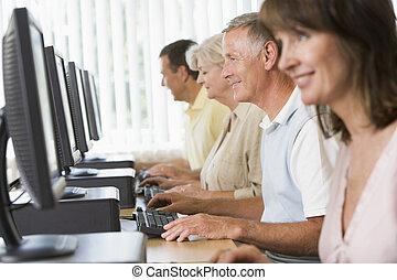 vier mensen, zitting bij computer, terminals, (selective, focus/high, key)