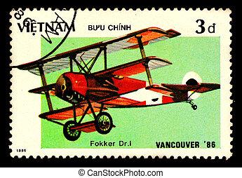 VIETNAM - CIRCA 1986: A stamp printed by VIETNAM shows military aircraft ( Fokker Dr.I ) Circa 1986