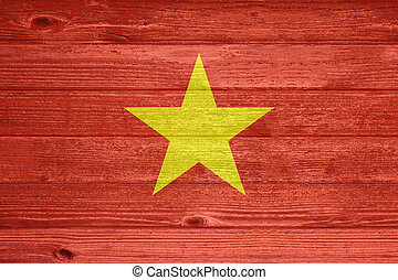 Vietnam Flag painted on old wood plank background.