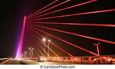 The Bai Chay Bridge in Ha Long, Vietnam. Traffic at night.