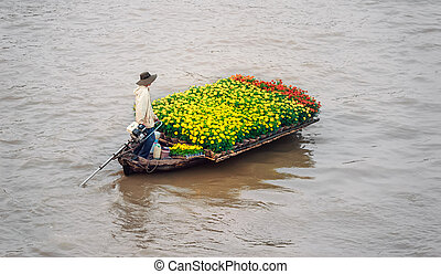 Vietnam, Mekong river delta. Boat on traditional floating...