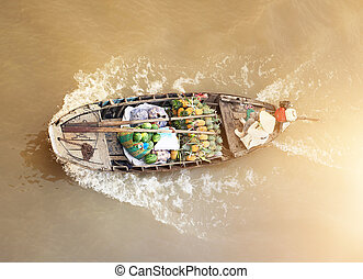 Vietnam, Mekong river delta. Boat on traditional floating ...
