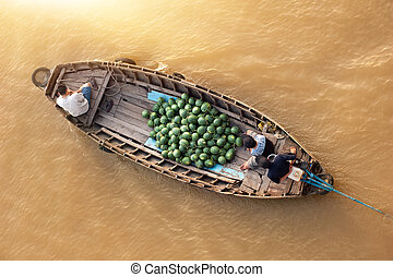 Vietnam, Mekong river delta. Boat on traditional floating...