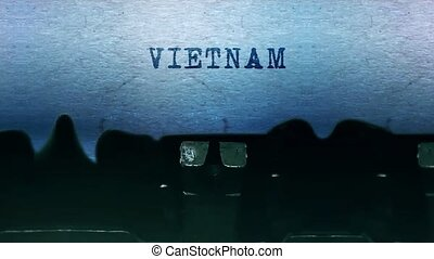 VIETNAM words Typing on a sheet of paper with an old vintage typewriter.