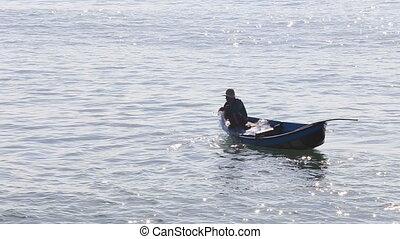 vietnamese fisherman pulls empty net out of water -...