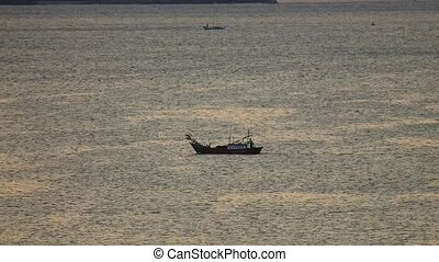 Fishing boat traveling across the south china sea, seascape scene central Vietnam panning panoramic viewpoint.