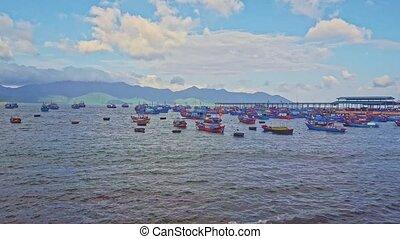 Vietnamese Fishing Boats Drift in Azure Sea at Dawn
