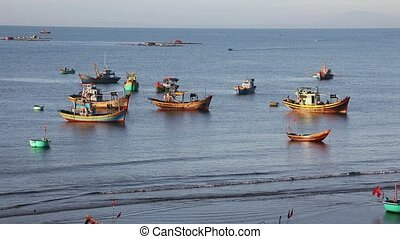 Vietnamese fishing boats in the early morning in Mui Ne,...