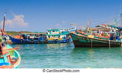 Vietnamese Fishing Boats Rock on Azure Waves in Bay