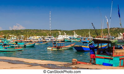 Vietnamese Fishing Boats Rock on Waves in Bay against Hills...