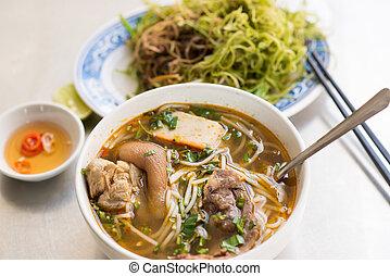 Vietnamese noodle soup Bun Bo Hue with fish source