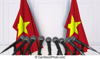 Vietnamese official press conference with flags of Vietnam....