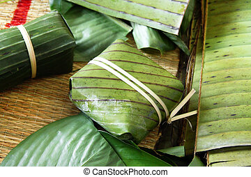 Vietnamese traditional cake for celebrating New Year from rice, meat and species wrapped in banana leaves -Tet cake.