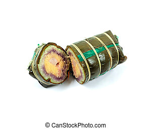 Vietnamese traditional new year cake with pork, mung bean, glutinous rice in banana leave
