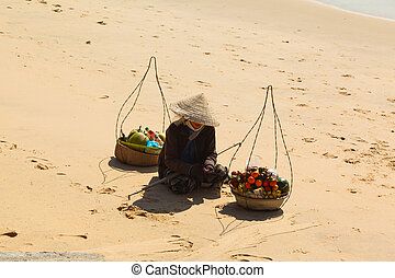 Vietnamese woman and fruit - Vietnamese woman in a straw hat...