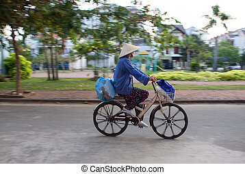 Vietnamese woman riding a bicycle