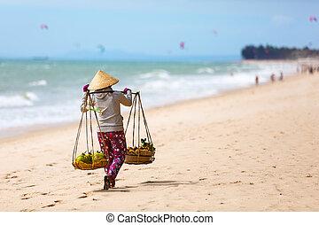 Vietnamese woman selling Fruits at Mui Ne beach. Vietnam